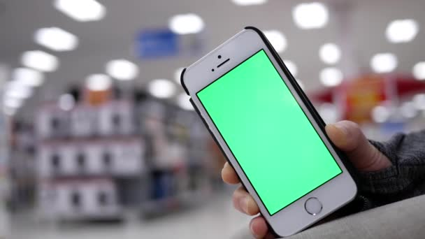 Walmart Stock Phone Number >> Woman Holding Green Screen Mobile Phone On Beautiful Blurred Lighting Background Inside Walmart Store