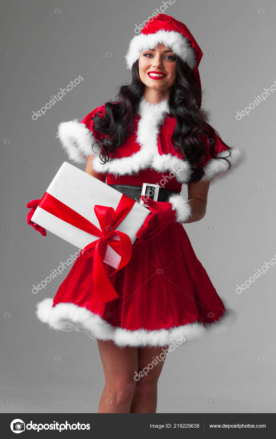 53b1c49db11 Woman Red Santa Claus Outfit Holding Christmas Gift Box — Stock ...