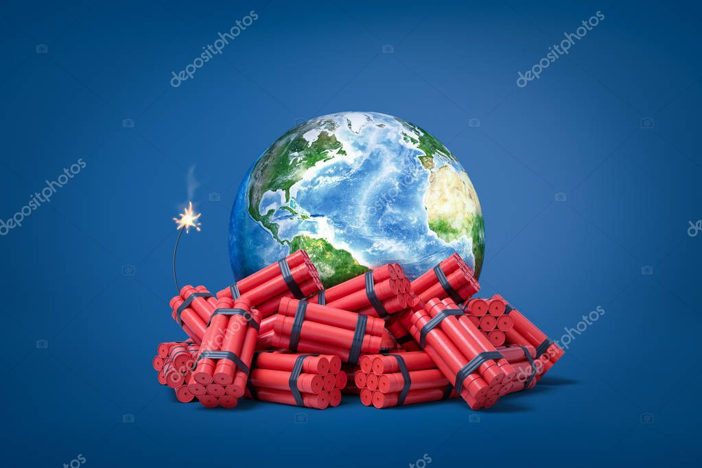3d rendering of a heap of dynamite bundles, one of them with a burning wick, with planet Earth seen behind.