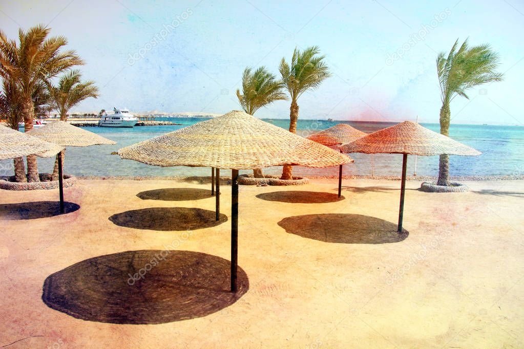 Photo of a macro retro beach with umbrellas and palm trees on the sea