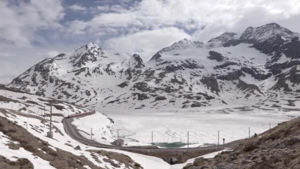 Bernina train pass through snowy mountains
