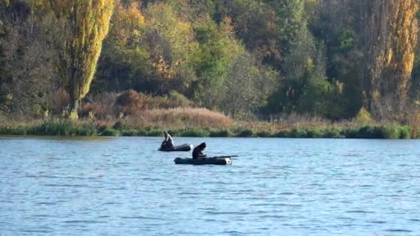 Vinnitsa, Ukraine - November 9, 2018: Autumn. Fishermen in rubber boats in the middle of the river are fishing