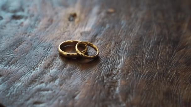 gold wedding rings on a wooden box
