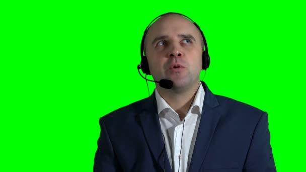 confident male customer service representative with headset in call center