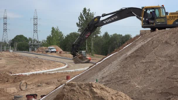 excavator machine level hill soil sand and roller working on road construction
