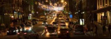 Blurred background. Night city lights blur. night city life: car and street lamps, retro style. panorama, banner.