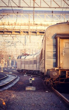 Russian passenger train. The Russian Railways. Railway in the spring at sunset.