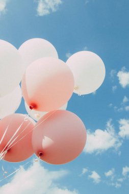 White pink balloons against the sky. Sunny weather and sky with clouds stock vector