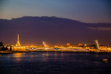 Divorce of bridges in St. Petersburg. Night city of Russia. The Neva River in the city center.