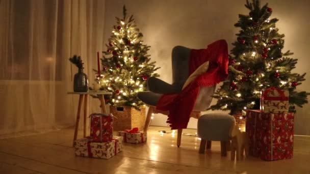 Decorated Christmas room HD video. Christmas tree and gifts. Shimmering garland. Merry Christmas and Happy New Year