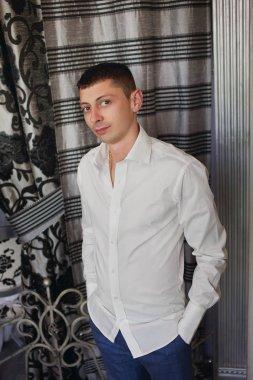 young beautiful caucasian groom man indoor celebrating wedding