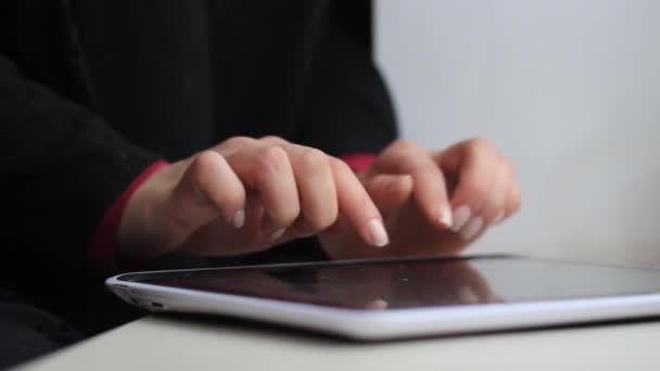 Womens hands work with a tablet computer