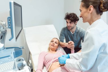 Couple in reproduction clinic being happy as the wife is pregnan