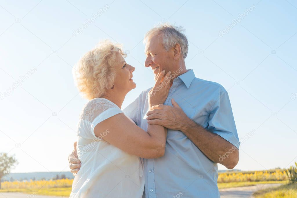 Romantic elderly couple enjoying health and nature in a sunny day