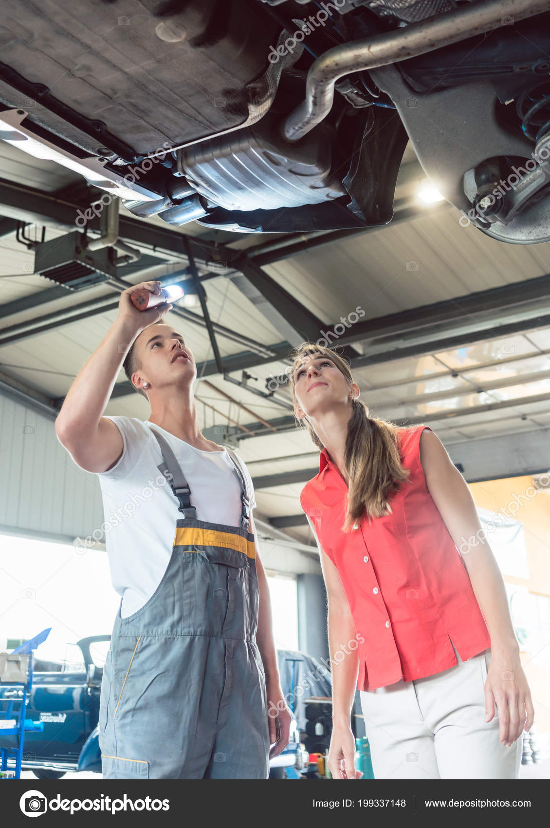 Reliable Auto Mechanics >> Reliable Auto Mechanic Checking The Car Of A Woman In A