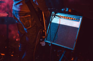 Guitar player in front of amplifier