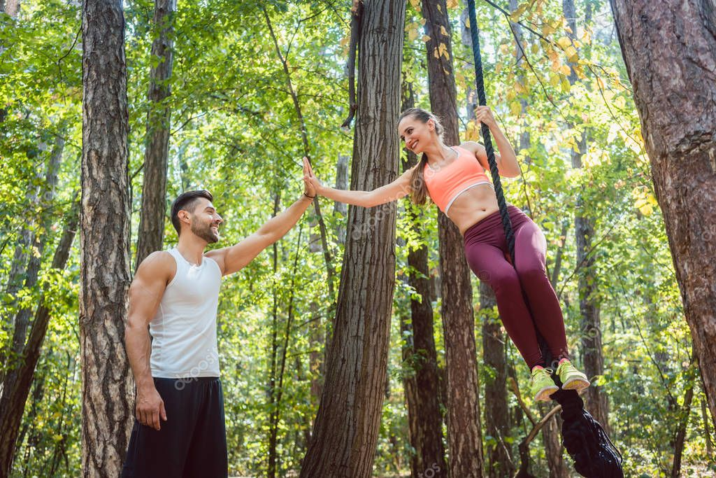 Man congratulating his girlfriend to finishing fitness exercise