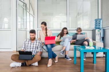 young people sharing a collaborative office space in a modern hu