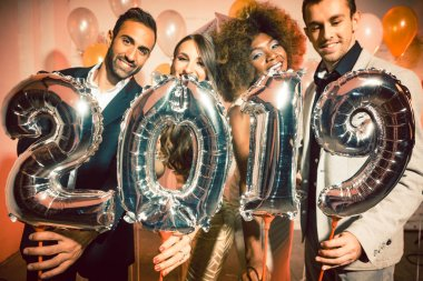 Party people women and men celebrating new years eve 2019