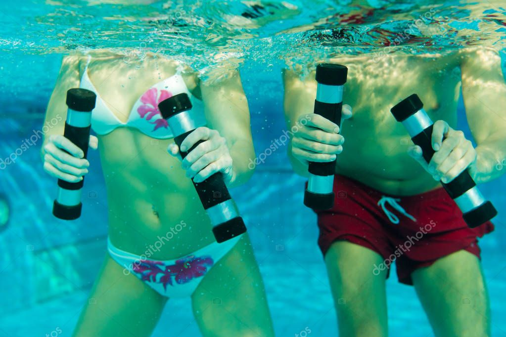 Couple exercising in swimming pool