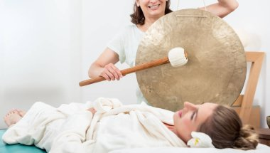 Smiling woman having sound massage