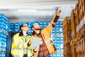 Photo Workers in a logistics warehouse planning the next project
