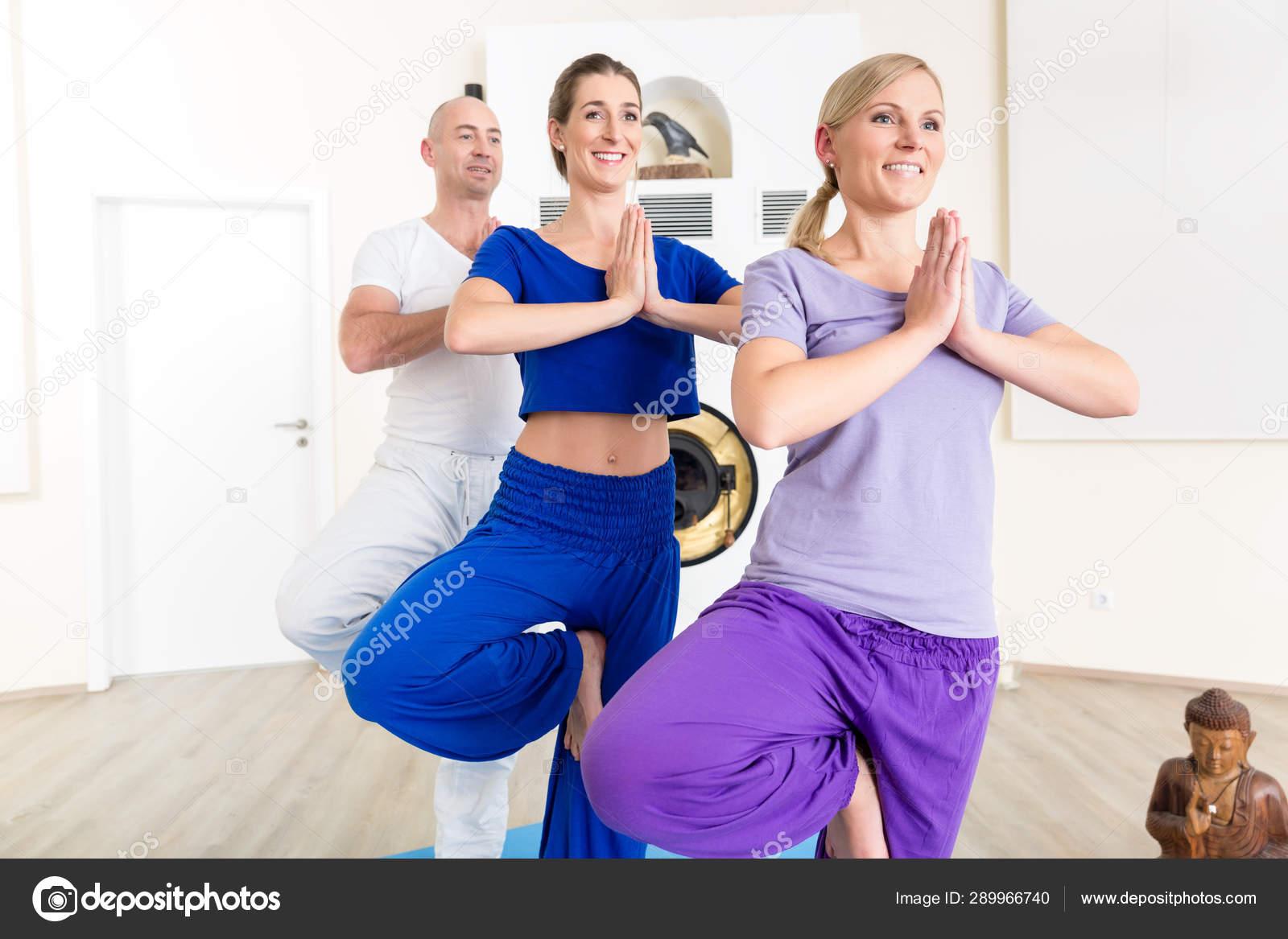 Three People Performing Yoga Pose Stock Photo C Kzenon 289966740