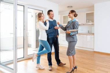Realtor giving house key to the buyers or tenants
