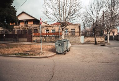 View on old Tbilisi streets and garbage bins