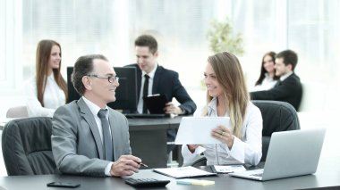 employees using digital tablet to work with financial data