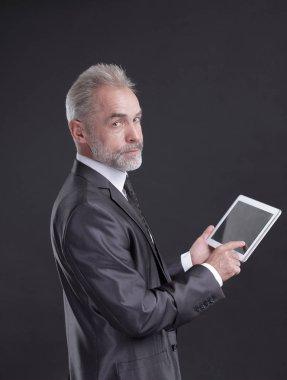 modern businessman using digital tablet.isolated on black background