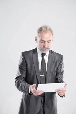 modern businessman with digital tablet.isolated on grey background