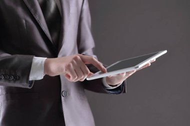 businessman pressing his finger on the screen of the digital tab