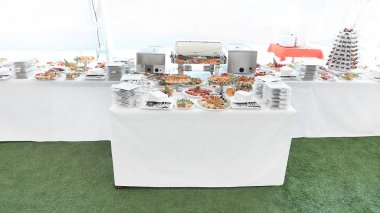 catering table set service with silverware and glass stemware in the restaurant before party