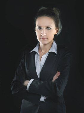 portrait of confident business woman .isolated on black background