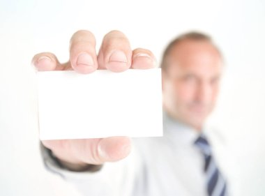 blurred image. businessman showing a blank business card