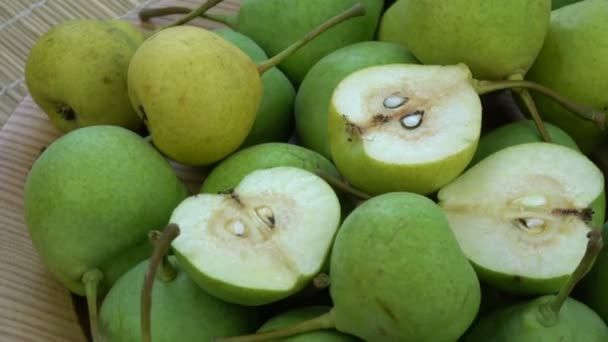 Rotating fresh juicy pears in wooden plate