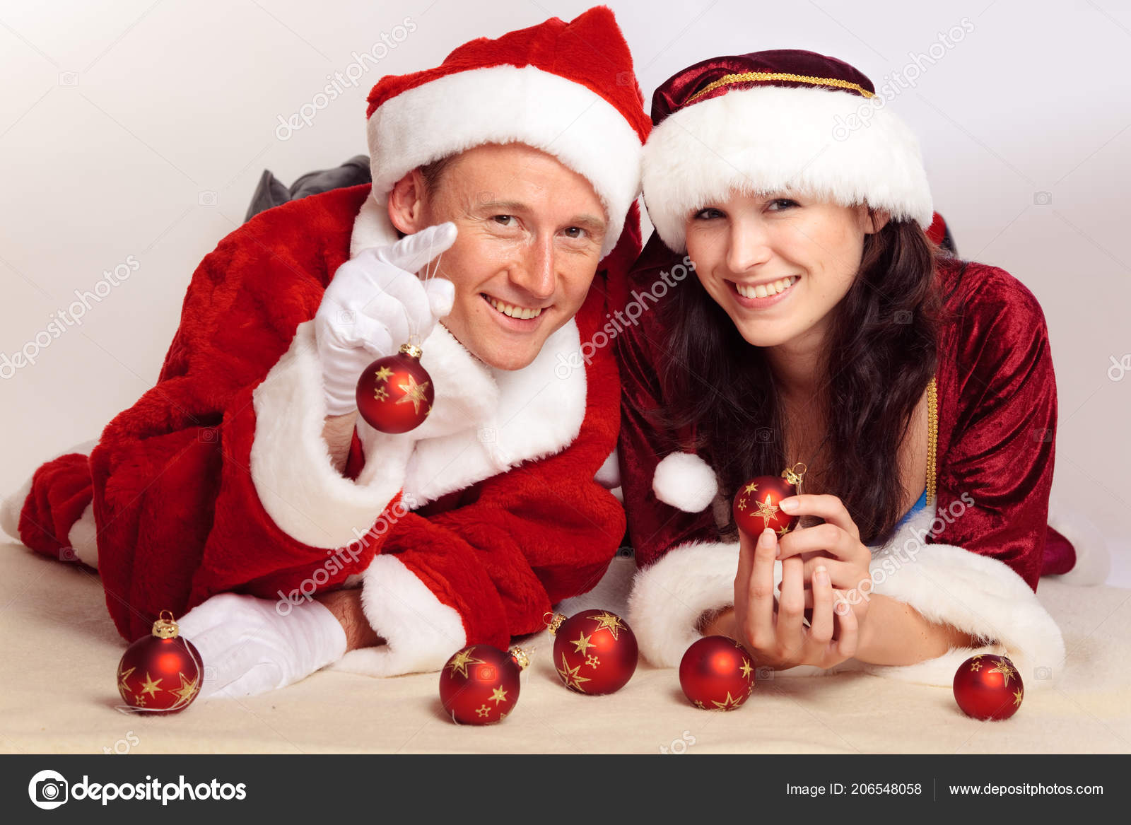 cute couple celebrating christmas stock photo
