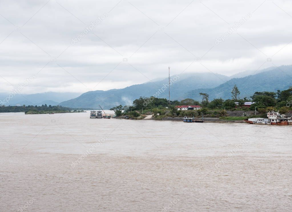 Small local port for the local freighter near the large river which are the border between Thailand and Laos.