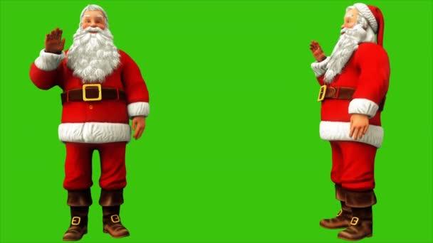 Santa Claus is intett a kezével a zöld képernyő 4k karácsonykor. Varrat nélküli hurok élénkség.