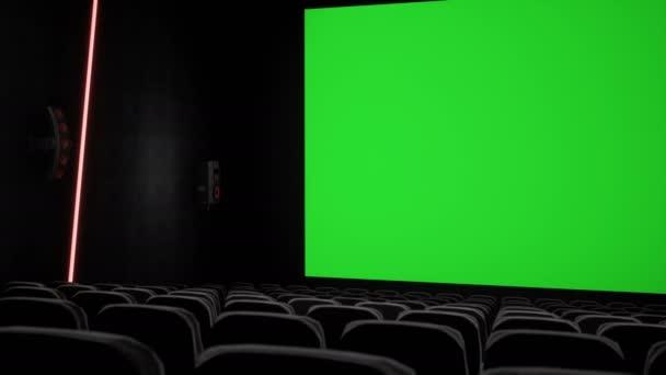 Mozi belső film színház a zöld képernyő és a üres helyek, üres mozi képernyőn. Film szórakoztató koncepció.