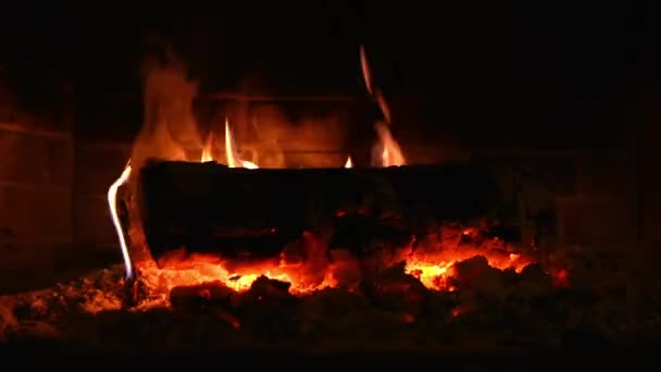 log is burning in fireplace at winter