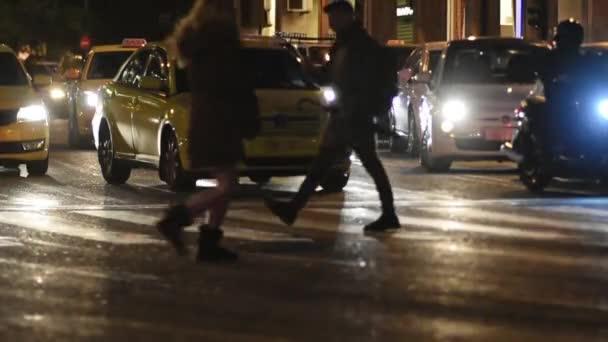 Hurry female runs to cross the street