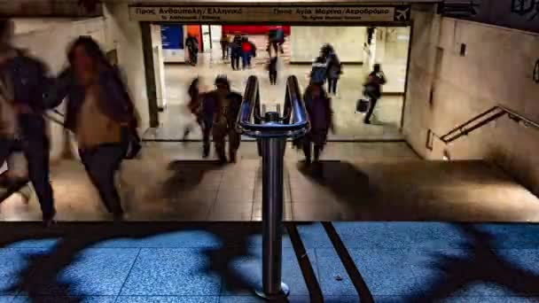 Time lapse of people walking in and out from the entrance of underground train station