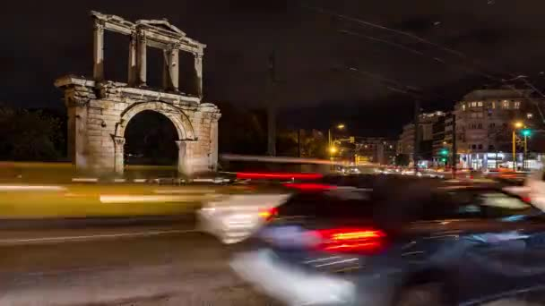 moving cars under Hadrian gate in Athens