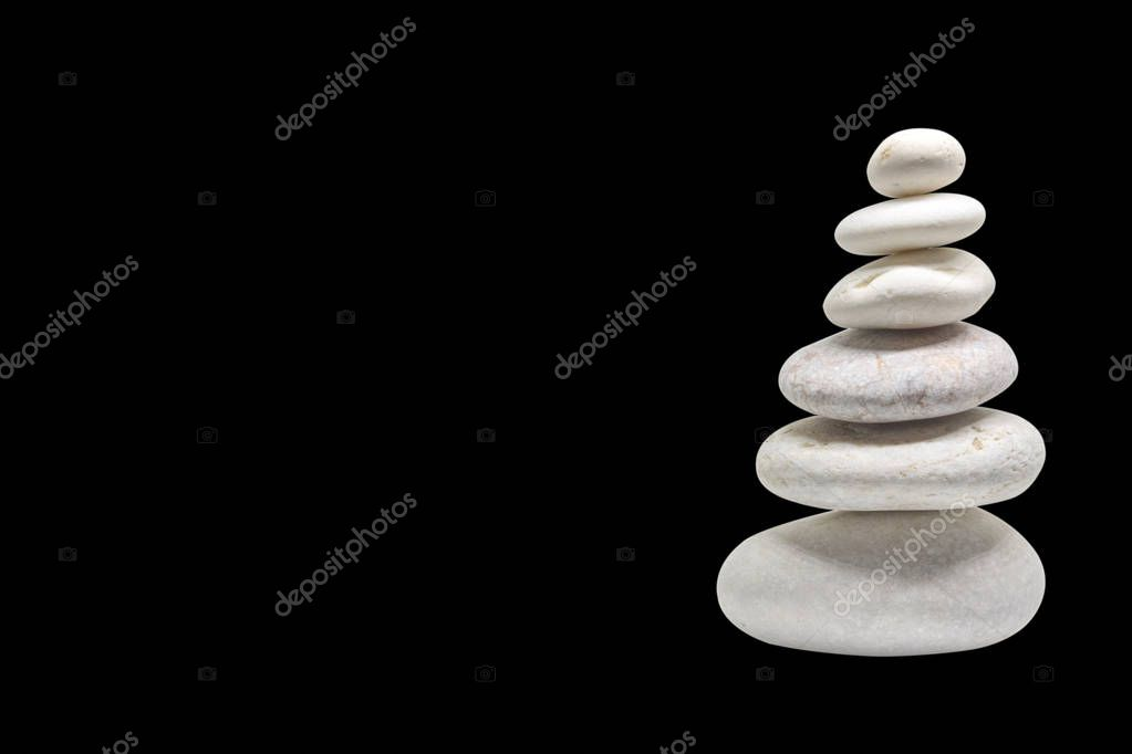 stacked pebbles isolated with black background