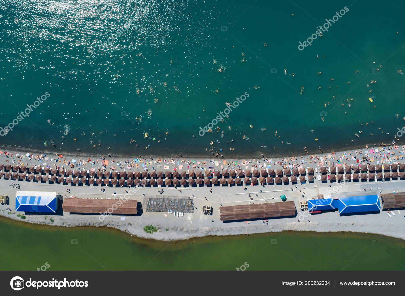 Top Aerial View Beach Sand Spit Rows Umbrellas Sunbeds Warm