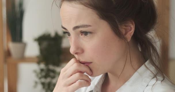 Worried woman regretting her mistake