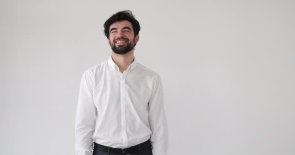 Businessman laughing over white background