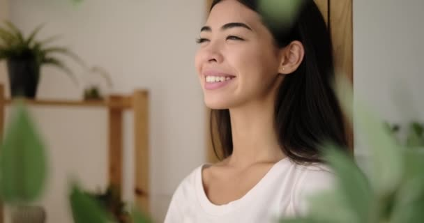 Pleased korean woman smiling at home